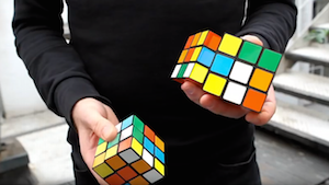 Solving 3 Rubik's Cubes in under 20 seconds whilst Juggling Mills Mess